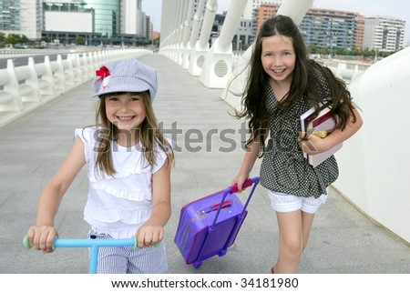 Little girls going to school with bags, books and student stuff - stock photo