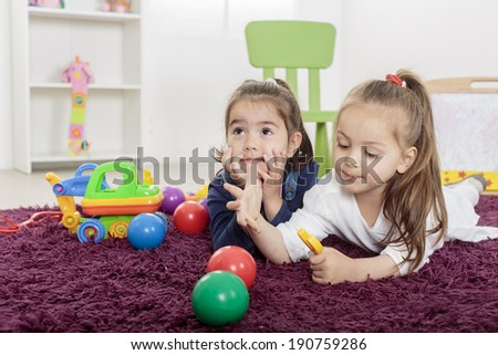 Little girls in the room - stock photo