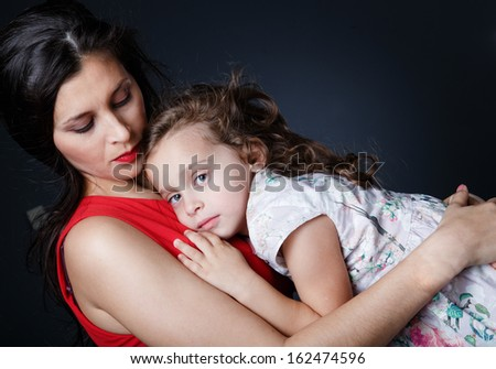 Little girls lies on her mother's chest - stock photo