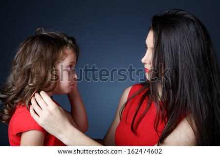 Little girls looks at her mother searching for soothing