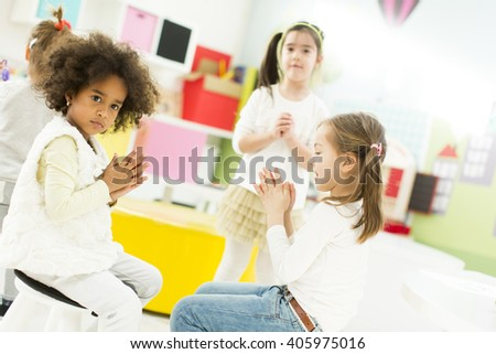 Little girls playing and learning in the kindergarten