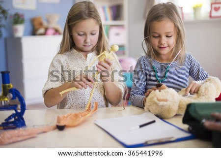 Little girls pretending to be a professional doctor - stock photo