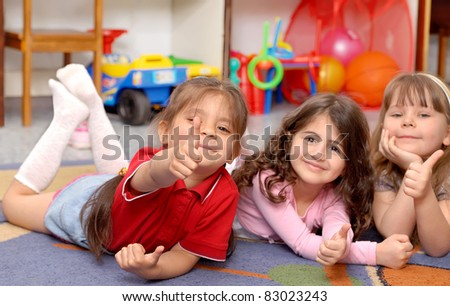 Little girls show sign OK - stock photo