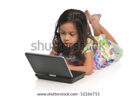 Little girls with a laptop computer isolated on a white background