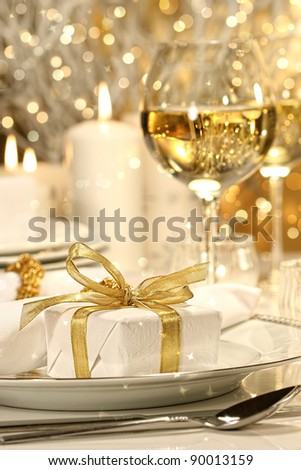 Little gold ribbon gift with gold background - stock photo