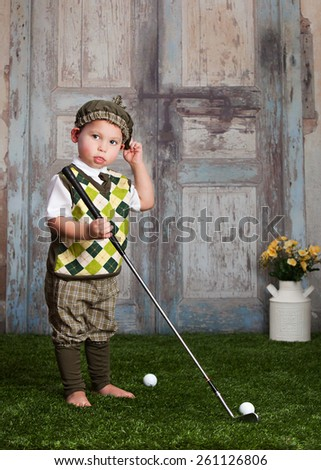 Little Golfer.  Adorable toddler playing golf. - stock photo