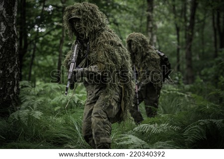 Little green men during patrol in forest - stock photo