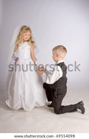 little groom and bride - stock photo