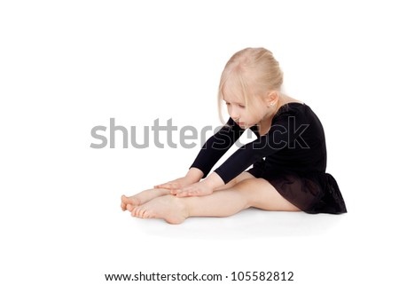little gymnast doing the gymnastic exercises