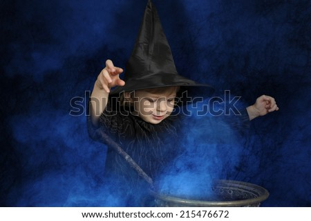little halloween witch brewing a potion - stock photo