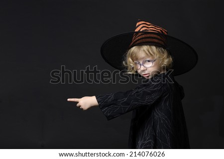 little halloween witch pointing her finger - stock photo