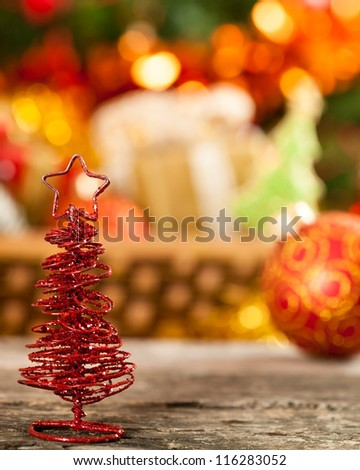 Little handmade Christmas tree against lights blurred background - stock photo