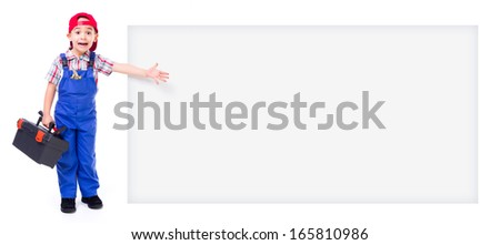 Little handyman with toolbox, shouting and pointing at big wide, empty advertising panel - stock photo