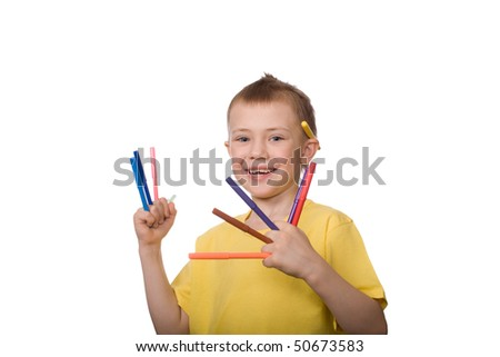 Little happy boy holds colorful markers