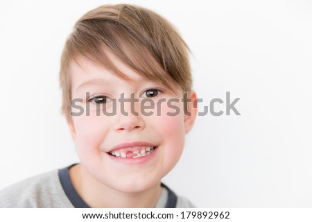Little happy boy missing a tooth - stock photo