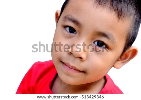 Little happy boy smiling  looking at camera portrait  isolated on a white background close-up