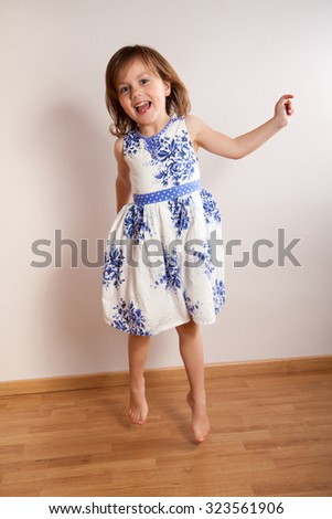 Little happy girl jumping - stock photo