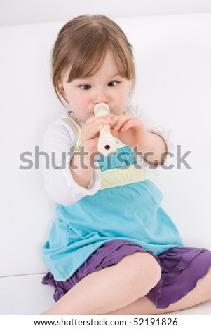little happy girl with flute - stock photo