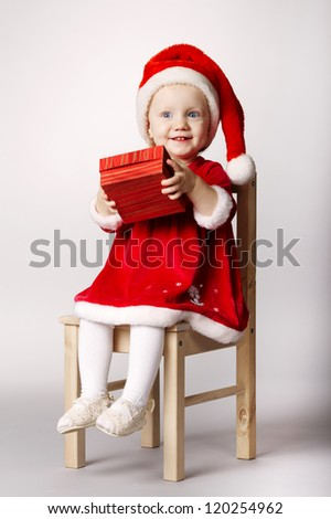 little happy girl with gift - stock photo