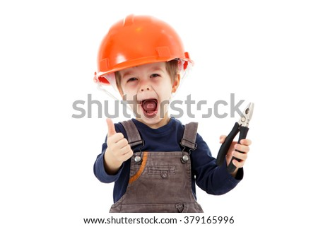 Little happy repairman in hardhat with pliers show thumb up on white - stock photo