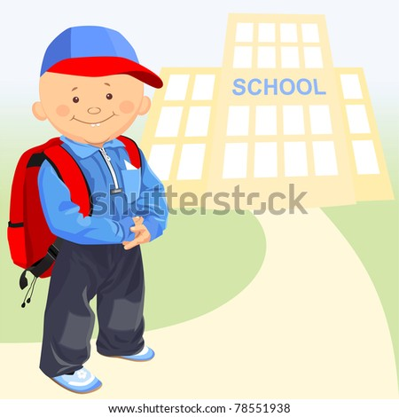 little happy schoolboy with a backpack on the background of the school - stock photo