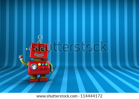 Little happy vintage toy robot waving happily over striped  background - stock photo