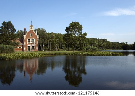 Little house with beautiful lake and forest. - stock photo