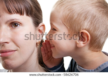 Little human child boy mother ear secrecy whisper - stock photo
