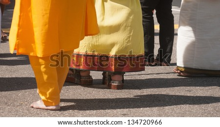 Little India, Singapore - Circa Jan, 2013: Thaipusam Festival. Man walking on the nail bed during the Thaipusam Festival - stock photo