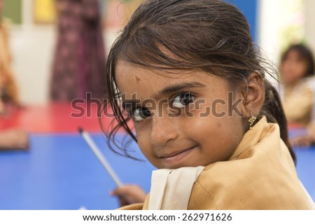 Little Indian girl in class - stock photo