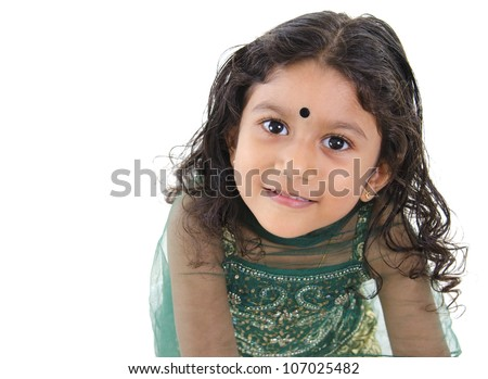 Little Indian girl looking up over white background - stock photo