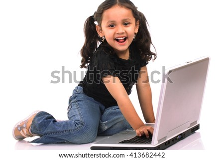 Little Indian girl with laptop - stock photo