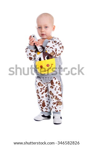 Little Kid boy dressed in cow costume with photo camera in hands. Isolated on white background - stock photo