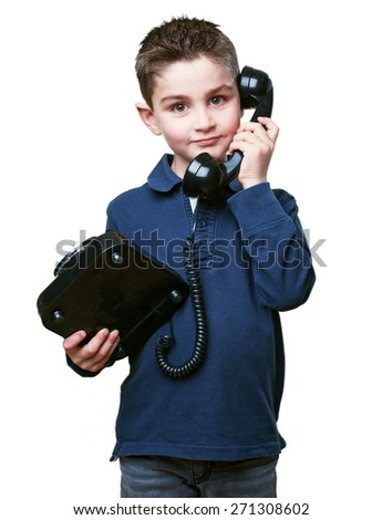 little kid calling with telephone - stock photo