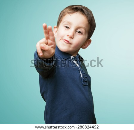little kid doing victory sign