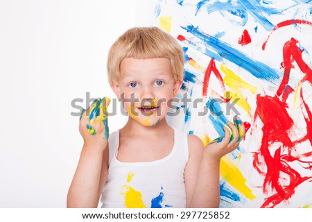 Little kid draws bright colors. School. Preschool. Education. Creativity. Studio portrait over white background - stock photo