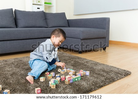 Little kid enjoy playing toy block - stock photo