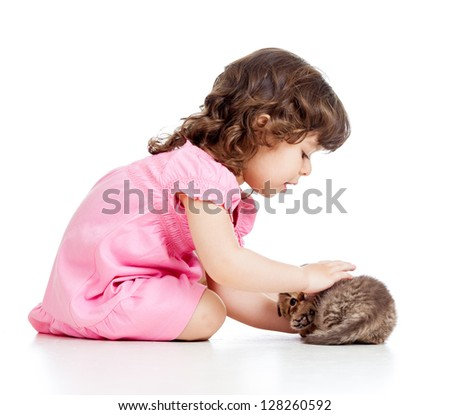 little kid girl playing with cat kitten - stock photo