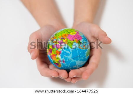 Little Kid Hands  holding World Globe isolated on white background - stock photo