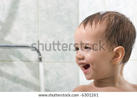 Little kid is bathing - stock photo