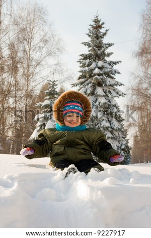 Little kid play with snow - stock photo