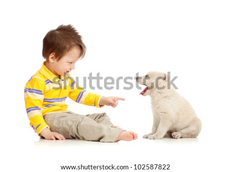 little kid training puppy on white background - stock photo