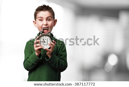 little kid with an alarm-clock