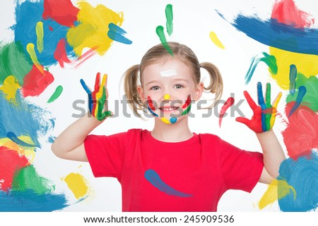 little kid with colored hands up