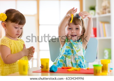 little kids have a fun together with colorful modeling clay at daycare creative toddlers molding - Images Of Little Kids