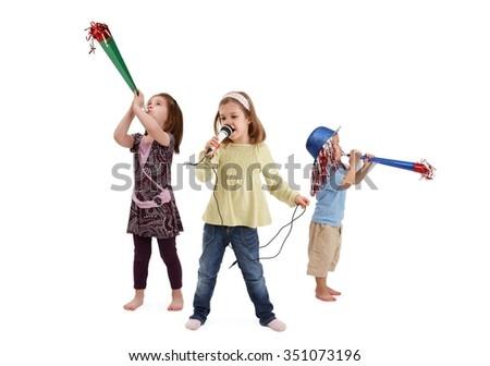 Little kids having party, trumpeting, singing, having fun. - stock photo