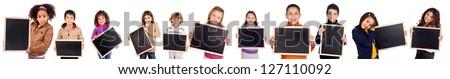 little kids holding a black board - stock photo