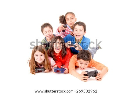 little kids playing videogames isolated in white - stock photo