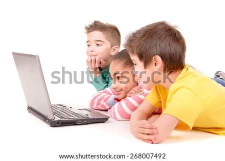 little kids with computer isolated in white background - stock photo