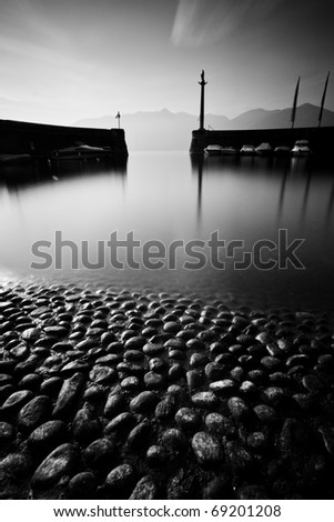 Little lake harbor in black and white - stock photo